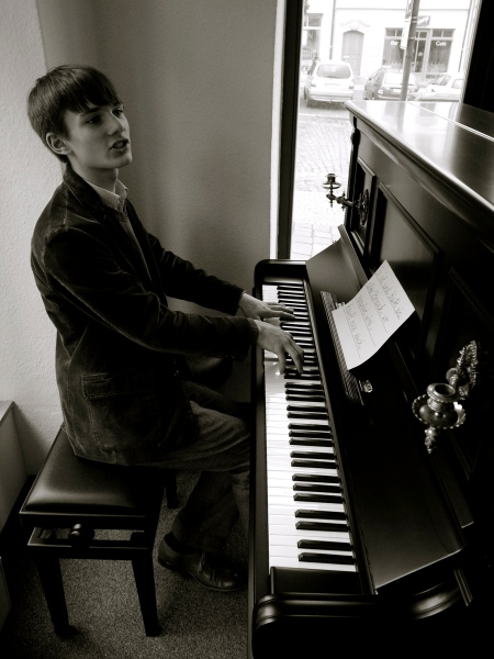 My Son At His New (Old) Piano