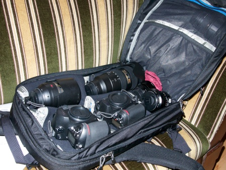 It is unique among camera backpacks because it has no stiff foam dividers for cameras and lenses inside the main compartment