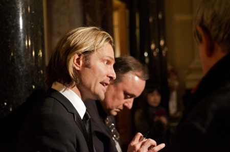 Eric Whitacre, composer and conductor of modern choral music, signing autographs and conversing with his audience after his concert in the Berlin cathedral on Dec. 22, 2010