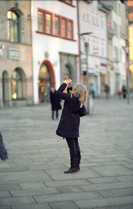 A photographer praying.