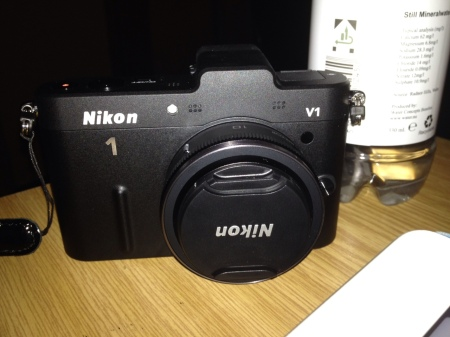 The Nikon 1 V1 really is much smaller than it looks here. That's a mini bottle of mineral water behind it.