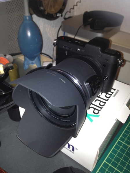 """The Nikon 1 V1 camera body pales in comparison to the huge 1 Nikkor VR 10-100mm f/4.5-5.6 PD-Zoom lens. And yes, I black out all my cameras with a sharpie pen. Didn't stick on the """"1"""" though ;)"""