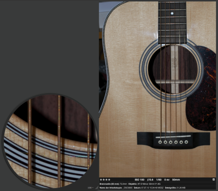 A very detailed and harmonic representation of the wood grain and the soundhole rosette of my Martin. Even though the strings are a bit in front of peak sharpness, their windings in combination with the high 24 MPixel resolution still elicit color moiré.