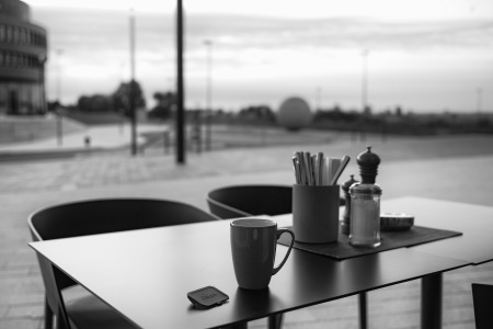 A lonely lens cap and a morning coffee.